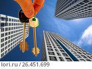 Купить «Ключи от квартиры на фоне новых высотных домов», фото № 26451699, снято 12 февраля 2017 г. (c) Сергеев Валерий / Фотобанк Лори