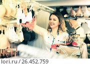 Купить «Smiling young woman customer choosing bras», фото № 26452759, снято 20 марта 2017 г. (c) Яков Филимонов / Фотобанк Лори