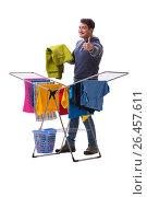 Купить «Husband man doing laundry isolated on white», фото № 26457611, снято 6 марта 2017 г. (c) Elnur / Фотобанк Лори
