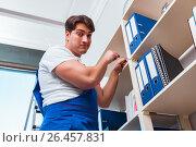 Купить «Male office cleaner cleaning shelves in office», фото № 26457831, снято 10 марта 2017 г. (c) Elnur / Фотобанк Лори