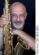 Купить «Man in black holding saxophone», фото № 26463451, снято 16 февраля 2006 г. (c) age Fotostock / Фотобанк Лори