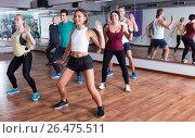 Купить «Men and ladies dancing zumba», фото № 26475511, снято 16 октября 2018 г. (c) Яков Филимонов / Фотобанк Лори