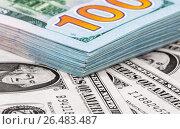 Купить «Heap of one hundred banknotes of american dollars close up», фото № 26483487, снято 7 января 2017 г. (c) FotograFF / Фотобанк Лори