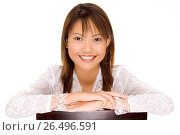 A pretty young asian girl with a gerat smile in a white silk blouse. Стоковое фото, фотограф mm-images/Ph. Date / age Fotostock / Фотобанк Лори