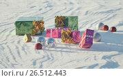Купить «Christmas gifts in a field on snow in a sunny, frosty and clear weather outdoors. Animation of emerging gifts. Cartoon.», видеоролик № 26512443, снято 9 мая 2017 г. (c) Mikhail Davidovich / Фотобанк Лори