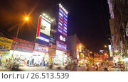 Купить «NHA TRANG, VIETNAM - OCTOBER 1, 2016: Evening view of the downtown Nha Trang city with illuminated signs on the shops and busses, motorbikes and bycicles on the traffic road at rainy weather», видеоролик № 26513539, снято 1 октября 2016 г. (c) Mikhail Davidovich / Фотобанк Лори