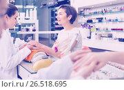 Купить «cheerful female manicurist filing and shaping nails in beauty salon», фото № 26518695, снято 28 апреля 2017 г. (c) Яков Филимонов / Фотобанк Лори