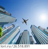 Купить «Plane encircled by buildings», фото № 26518891, снято 19 октября 2018 г. (c) Яков Филимонов / Фотобанк Лори