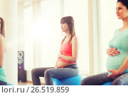 happy pregnant women exercising on fitball in gym. Стоковое фото, фотограф Syda Productions / Фотобанк Лори