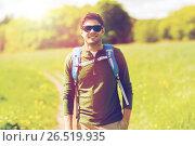 Купить «happy young man with backpack hiking outdoors», фото № 26519935, снято 27 мая 2016 г. (c) Syda Productions / Фотобанк Лори