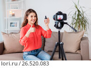Купить «woman with foundation and camera recording video», фото № 26520083, снято 22 декабря 2016 г. (c) Syda Productions / Фотобанк Лори