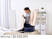Купить «woman packing travel bag at home or hotel room», фото № 26520091, снято 18 января 2017 г. (c) Syda Productions / Фотобанк Лори