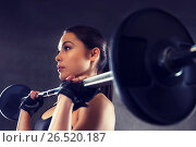 Купить «young woman flexing muscles with barbell in gym», фото № 26520187, снято 12 декабря 2015 г. (c) Syda Productions / Фотобанк Лори