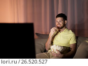Купить «happy man with popcorn watching tv at night», фото № 26520527, снято 26 ноября 2016 г. (c) Syda Productions / Фотобанк Лори