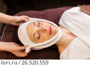 Купить «woman having face massage with towel at spa», фото № 26520559, снято 26 января 2017 г. (c) Syda Productions / Фотобанк Лори