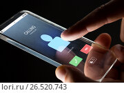 Купить «close up of hand with incoming call on smartphone», фото № 26520743, снято 6 сентября 2016 г. (c) Syda Productions / Фотобанк Лори