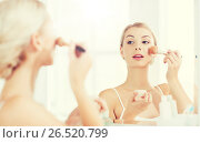 Купить «woman with makeup brush and powder at bathroom», фото № 26520799, снято 13 февраля 2016 г. (c) Syda Productions / Фотобанк Лори