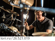 Купить «male musician playing drums and cymbals at concert», фото № 26521019, снято 18 августа 2016 г. (c) Syda Productions / Фотобанк Лори
