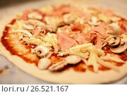 Купить «close up of pizza with cheese, ham and champignons», фото № 26521167, снято 17 февраля 2017 г. (c) Syda Productions / Фотобанк Лори