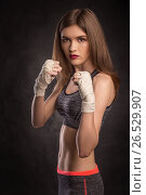 Young and fit female fighter in fighting stand (2017 год). Редакционное фото, фотограф VictorStudio / Фотобанк Лори