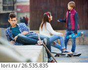 Upset boy and couple of teens apart. Стоковое фото, фотограф Яков Филимонов / Фотобанк Лори