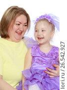 Купить «A happy mother hugs her beloved daughter», фото № 26542927, снято 28 апреля 2017 г. (c) Сергей Колесников / Фотобанк Лори