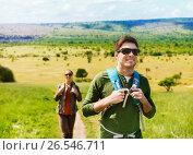 Купить «happy couple with backpacks traveling in africa», фото № 26546711, снято 27 мая 2016 г. (c) Syda Productions / Фотобанк Лори
