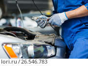 Купить «mechanic man with wrench repairing car at workshop», фото № 26546783, снято 1 июля 2016 г. (c) Syda Productions / Фотобанк Лори