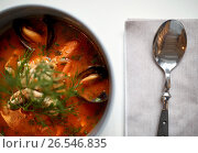 Купить «close up of seafood soup with fish and mussels», фото № 26546835, снято 16 января 2017 г. (c) Syda Productions / Фотобанк Лори