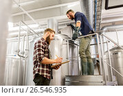 Купить «men with clipboard at craft brewery or beer plant», фото № 26546935, снято 24 марта 2017 г. (c) Syda Productions / Фотобанк Лори