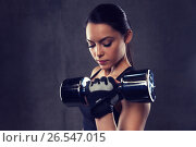 Купить «young woman flexing muscles with dumbbells in gym», фото № 26547015, снято 12 декабря 2015 г. (c) Syda Productions / Фотобанк Лори