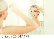Купить «woman with tweezers tweezing eyebrow at bathroom», фото № 26547179, снято 13 февраля 2016 г. (c) Syda Productions / Фотобанк Лори