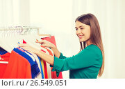 Купить «happy woman choosing clothes at home wardrobe», фото № 26549051, снято 19 февраля 2016 г. (c) Syda Productions / Фотобанк Лори