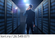 Купить «Businessman over server room background», фото № 26549071, снято 7 ноября 2018 г. (c) Syda Productions / Фотобанк Лори