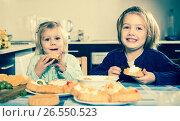 Купить «Two little girls enjoying pastry with cream», фото № 26550523, снято 14 декабря 2018 г. (c) Яков Филимонов / Фотобанк Лори