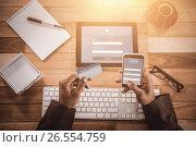 Купить «Composite image of online banking», фото № 26554759, снято 30 марта 2020 г. (c) Wavebreak Media / Фотобанк Лори