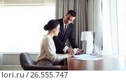 Купить «business team with papers and tablet pc at hotel», видеоролик № 26555747, снято 16 июля 2019 г. (c) Syda Productions / Фотобанк Лори