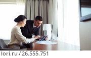 Купить «business team with papers and tablet pc at hotel», видеоролик № 26555751, снято 25 июня 2019 г. (c) Syda Productions / Фотобанк Лори