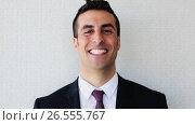 Купить «happy smiling businessman or man in suit», видеоролик № 26555767, снято 26 июня 2019 г. (c) Syda Productions / Фотобанк Лори