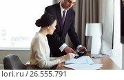 Купить «business team with papers and tablet pc at hotel», видеоролик № 26555791, снято 25 июня 2019 г. (c) Syda Productions / Фотобанк Лори