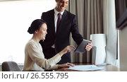 Купить «business team with papers and tablet pc at hotel», видеоролик № 26555795, снято 22 июля 2019 г. (c) Syda Productions / Фотобанк Лори