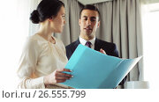 Купить «business team with papers working at hotel room», видеоролик № 26555799, снято 16 июля 2019 г. (c) Syda Productions / Фотобанк Лори