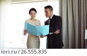 Купить «business team with papers working at hotel room», видеоролик № 26555835, снято 7 июня 2017 г. (c) Syda Productions / Фотобанк Лори