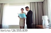 Купить «business team with papers working at hotel room», видеоролик № 26555839, снято 27 мая 2017 г. (c) Syda Productions / Фотобанк Лори