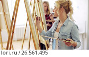 Купить «students with easels painting at art school», видеоролик № 26561495, снято 2 июля 2020 г. (c) Syda Productions / Фотобанк Лори