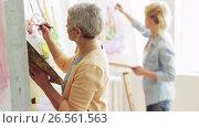 Купить «group of students painting at art school studio», видеоролик № 26561563, снято 19 февраля 2020 г. (c) Syda Productions / Фотобанк Лори