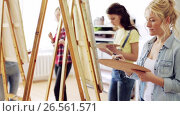 Купить «students with easels painting at art school», видеоролик № 26561571, снято 27 мая 2017 г. (c) Syda Productions / Фотобанк Лори