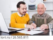 Купить «Old man signed car purchase contract», фото № 26565811, снято 23 мая 2020 г. (c) Яков Филимонов / Фотобанк Лори