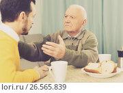 Купить «Father and son arguing», фото № 26565839, снято 22 сентября 2018 г. (c) Яков Филимонов / Фотобанк Лори