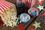 Scattered popcorn and sweet food decorated with 4th july theme, фото № 26569091, снято 10 февраля 2017 г. (c) Wavebreak Media / Фотобанк Лори